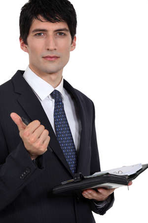 Businessman holding agenda photo
