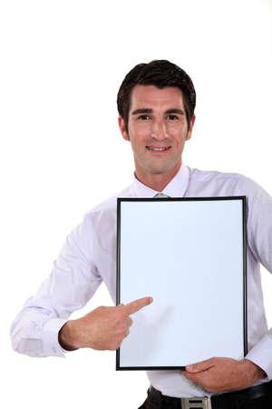 Man holding up a blank bulletin board Stock Photo - 14195387