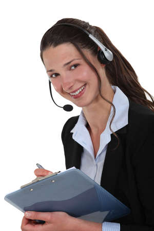 Cheerful call-center supervisor with clip-board photo