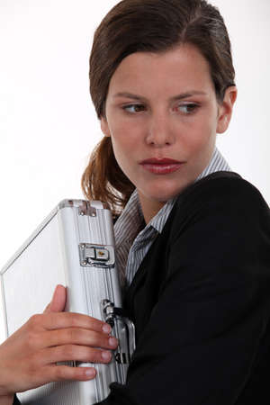 clutching: Businesswoman clutching metal briefcase Stock Photo