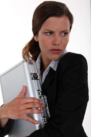 possessive: Woman protecting a briefcase