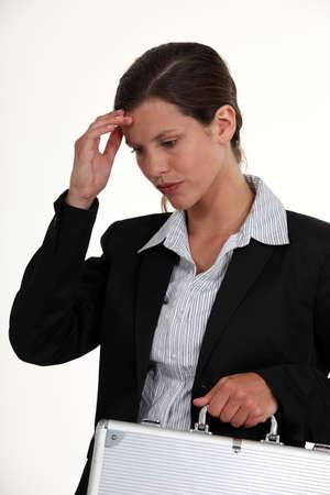 splitting headache: Woman suffering from a headache