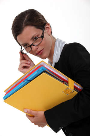 placing: Woman with glasses and folders in hand