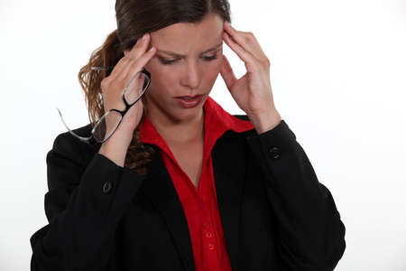 young female executive having migraine Stock Photo - 14194724
