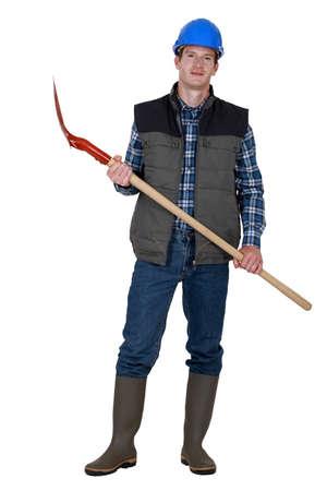 obrero: Trabajador sosteniendo una pala Foto de archivo