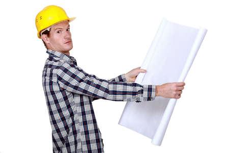btp: Builder going over construction plans Stock Photo