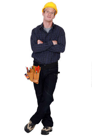Full length worker with a tool belt photo