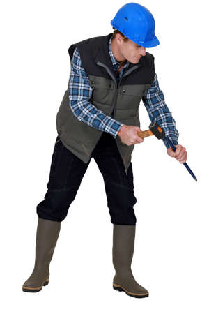 sculpt: Laborer using hammer on white background