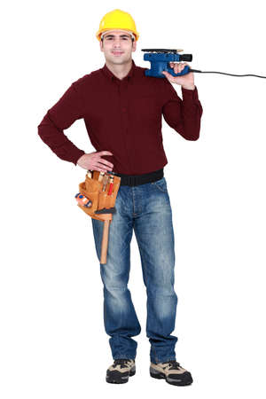 smoothen: Tradesman holding a sander