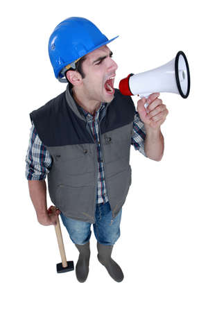 irked: Angry tradesman yelling into a megaphone