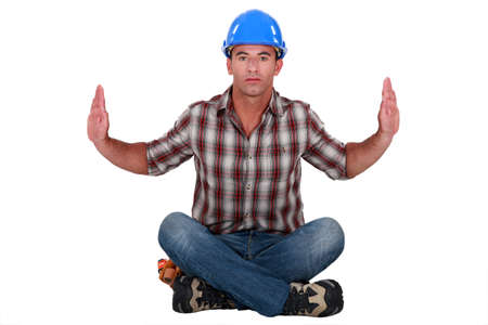 austere: Austere tradesman leaning forward and holding up his arms