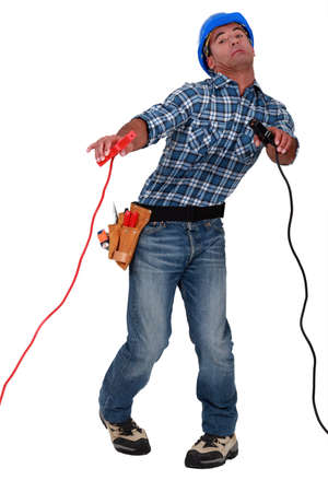 Electrician holding crocodile clips photo