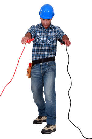 Laborer with battery clips in hands photo