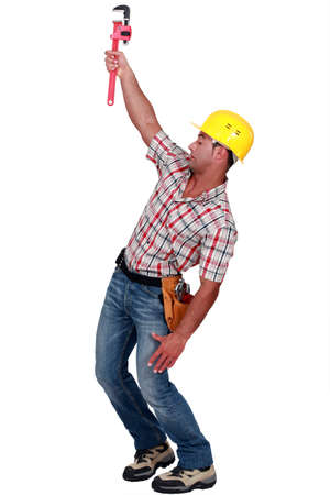 Laborer trying to hang on with a caliper photo