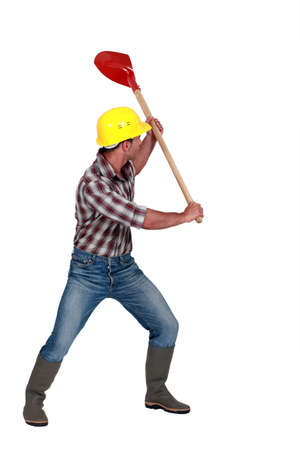Workman brandishing a shovel on white background
