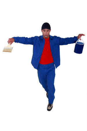 counterbalance: Decorator walking an imaginary tightrope Stock Photo