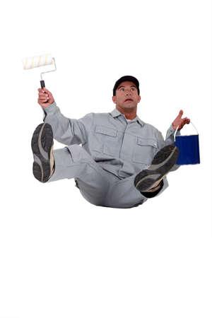 clumsiness: Painter falling backwards