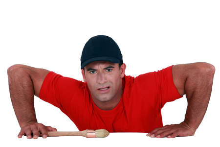 groaning: Muscular man lifting himself up onto a ledge