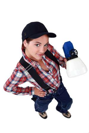 tradeswoman: Tradeswoman holding a spray gun