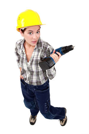 workwoman: Tradeswoman holding a battery-powered power tool