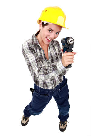 pep: Woman with a power drill