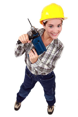 Young woman holding drill Stock Photo - 14195446