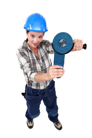 stone cutter: Woman holding angle-grinder