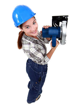craftswoman: craftswoman holding an electric saw