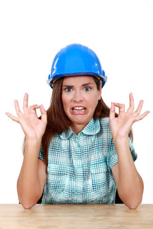Woman with helmet and face of disgust Stock Photo - 14195221