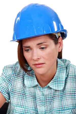Sad female builder photo