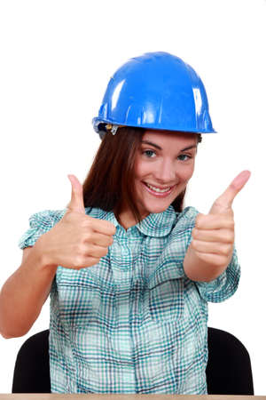A female construction worker giving both thumbs up. photo