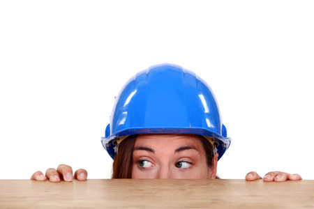 tradeswoman: Tradeswoman peeping out from beneath a table