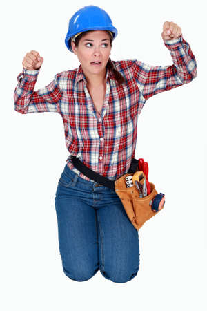 craftswoman: craftswoman kneeling and clenching her fists