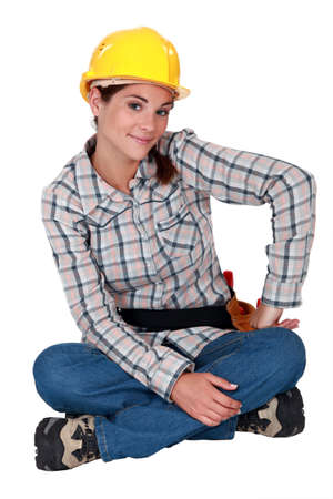 beatitude: young craftswoman sitting cross-legged