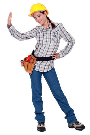 sideway: A female manual worker making a stop sign. Stock Photo
