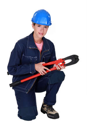 workwoman: Tradeswoman holding large clippers Stock Photo