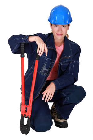 A female construction worker with pliers. Stock Photo