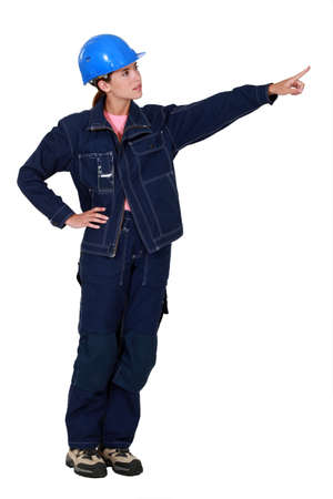 Woman construction worker showing something Stock Photo - 14194456