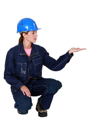 Young woman plumber