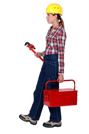 Woman with a toolbox and wrench Stock Photo - 14194352