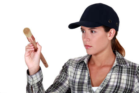 unemotional: Woman holding a paintbrush