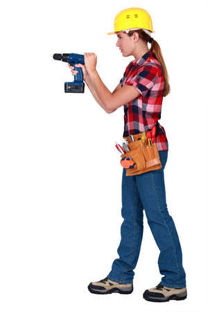 Woman with drill Stock Photo - 14194411