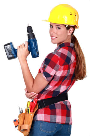 Profile of woman holding drill photo