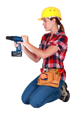 Woman with a cordless drill Stock Photo - 14195368