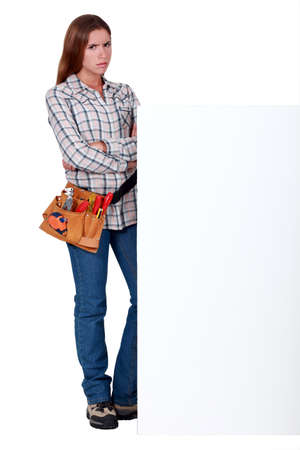 disapprove: Angry woman standing behind a wall