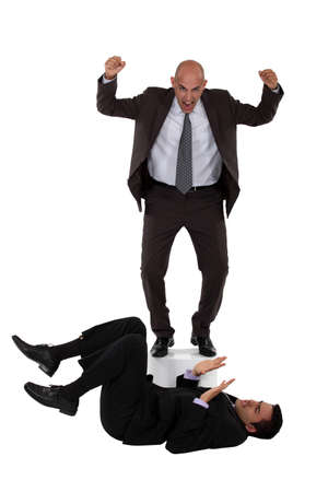 arguing: Angry boss shouting at employee laying on the floor