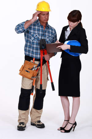 scratching head: Architect and builder discussing a job