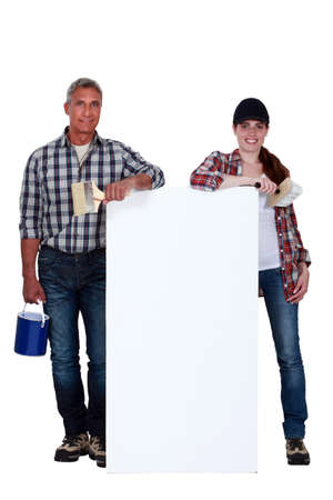 Decorators with a board left blank for your message photo
