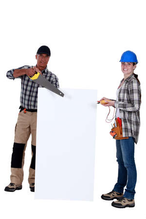 construction crew: Carpenter and electrician with a blank board