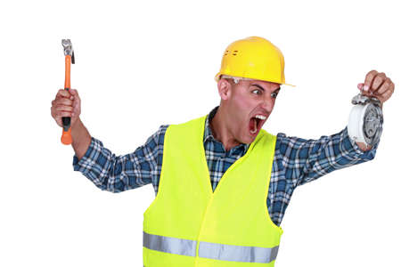 oversleep: Angry tradesman looking at the time